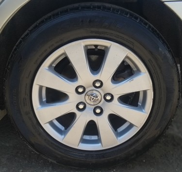 Original 16 Inch Toyota Rims With Tire
